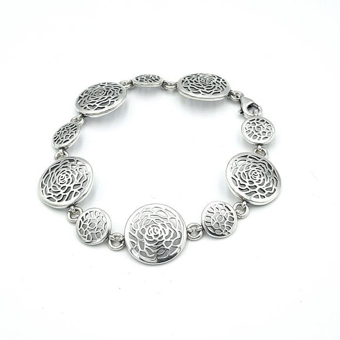 Bransoletka srebrna oksydowana - ażurowe koła